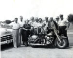 A Group of People and a Dog on a Motorcycle